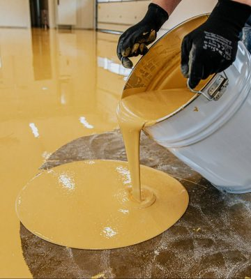 yellow-epoxy-coating-being-poured-on-a-los-angles-floor