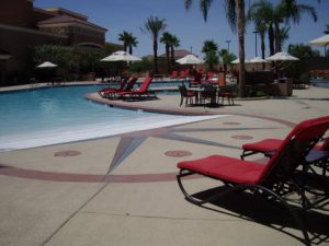 resurfaced-pool-deck-in-los-angeles-with-red-chairs