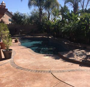 orange-county-pool-deck-resurfaced-with-stain-and-stamp